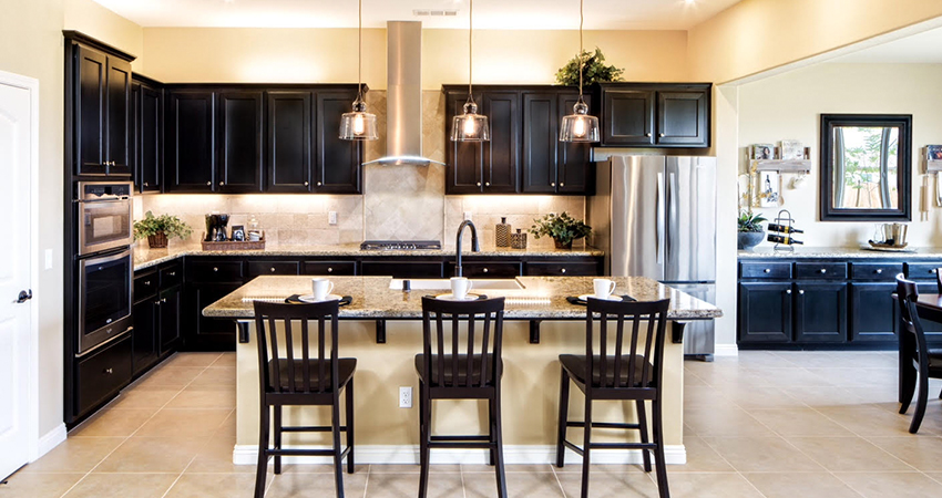 Interior features spacious gourmet kitchens with slab granite, stainless steel double ovens, and large kitchen islands that are suitable for entertaining.