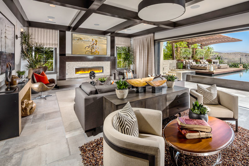 Folding walls extend the living area of the Cassis family room into the inviting outdoor living space.