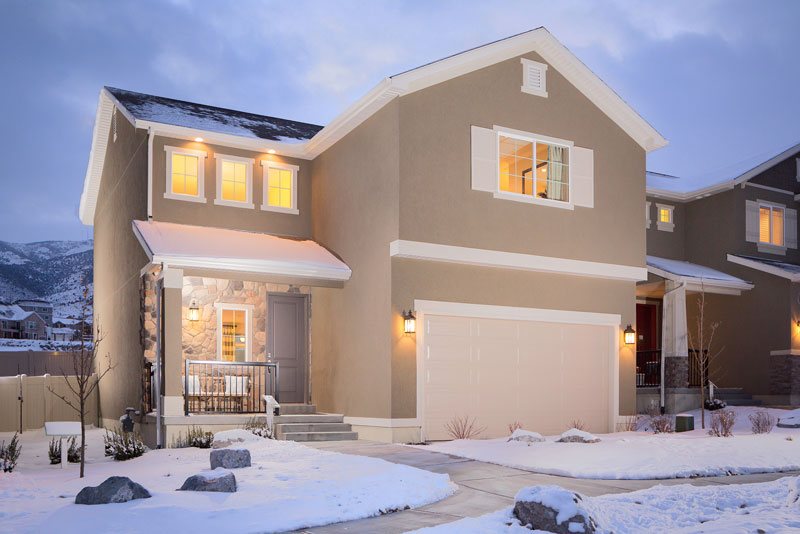Homes feature 30-year upgraded architectural shingles, full masonry exteriors, and two-car garages with coach lights and weather-resistant, roll-up garage doors made from decorative steel.