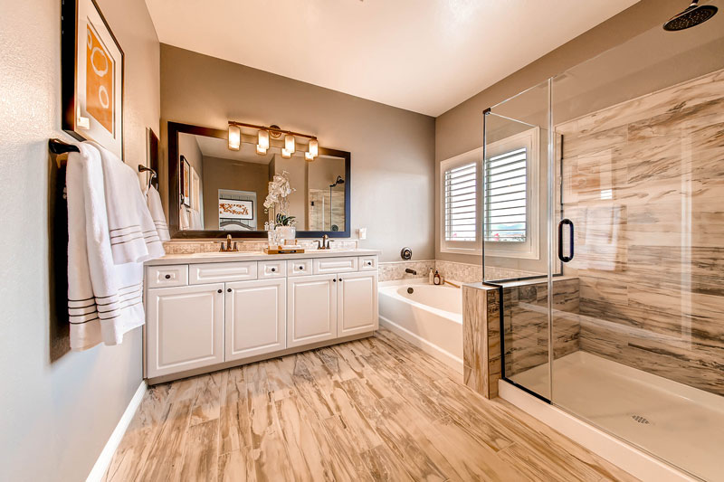 The neutrals palette extends through the master bath and bedroom for a natural feel.