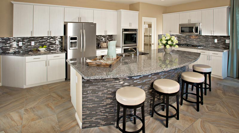 The Cloud Nine plan in the Dorado Springs community in Nevada boasts granite countertops and an oversized island, a feature noticeable in many recent Beazer communities.