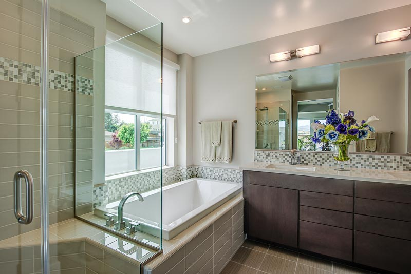 Water-saving toilets and showers, tankless water heaters, walk-in showers, and high-end finishes and fixtures come together to create a sustainable, relaxing, spa-like atmosphere in the generous bathrooms at 1756 Cole.