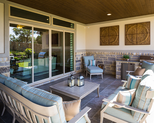 The outdoor living area has the option of adding an outdoor kitchen and comes wired for an outdoor fan to the area cool in the Texas summers.