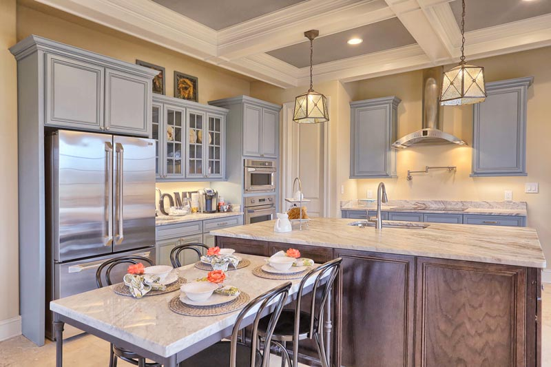 Each kitchen uses GE Profile ENERGY STAR® appliances and provides plenty of cooking space while socializing.