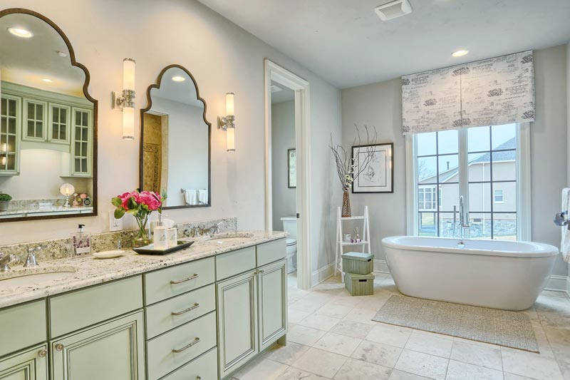 The master bathroom features Age-In-Place options including wider doors and hallways, curbless showers, and is American Disabilities Association (ADA) friendly.