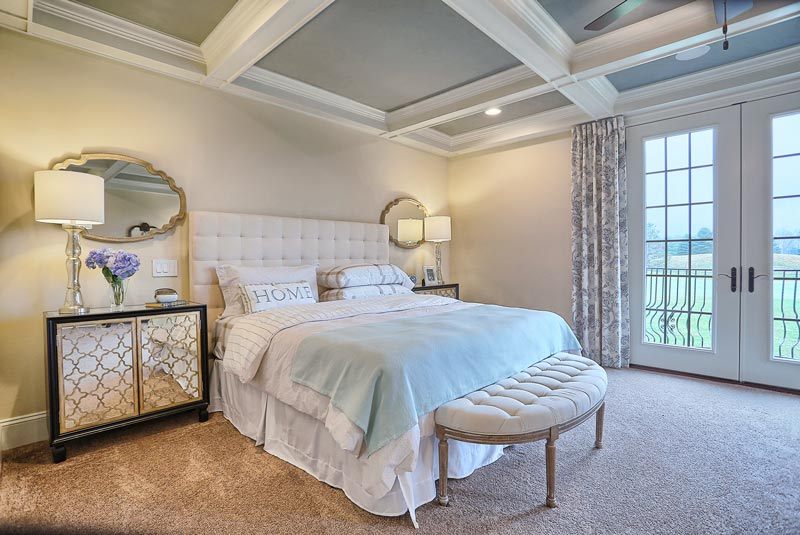 The master bedroom is adjoined to the master bath for easy access and a wonderful balcony view of the sweeping vistas.