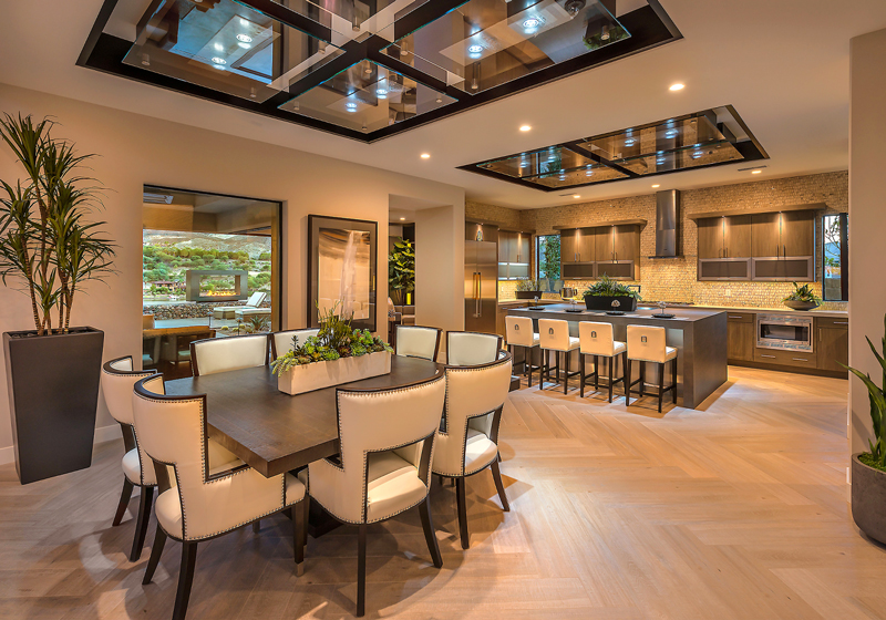 Gourmet kitchens and gathering spaces feature expansive views through covered verandas or interior courtyards.