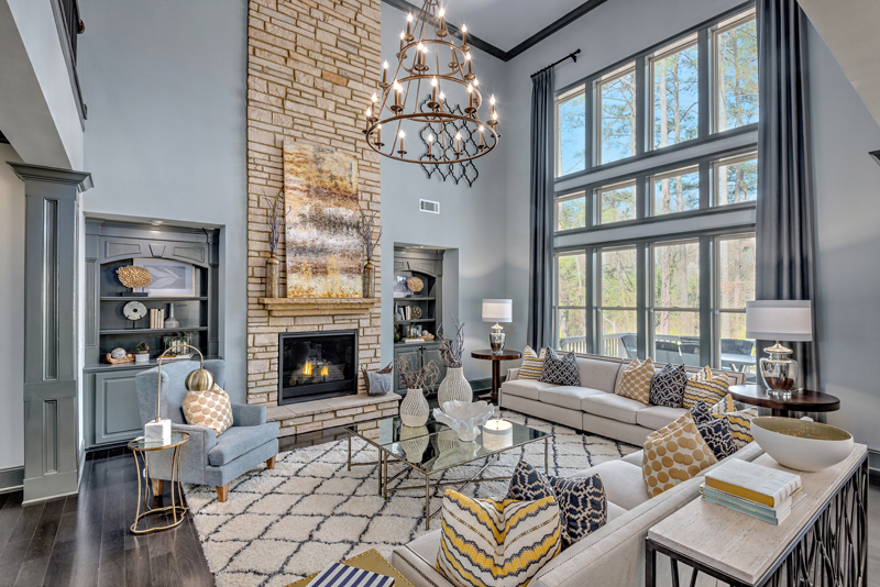 The great room area has high vaulted ceilings and almost cathedral-esc large paned windows, all of which is viewable from just up the staircase.