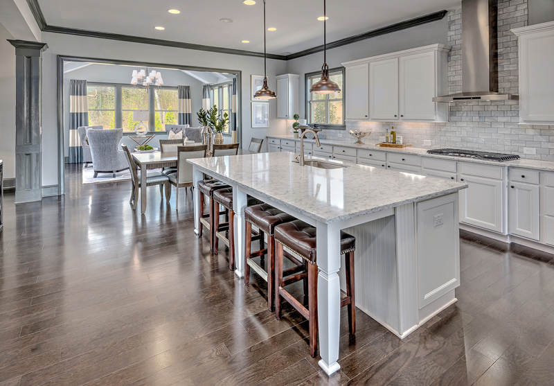 Most floor plans have an expansive kitchen that includes a large center island in the chef's kitchen with stainless steel cooking appliances and surfacing.