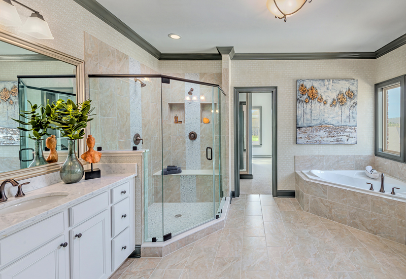 "The owner's bathroom has a ""his and hers"" sink combo as well as a sit-in shower and tub for those moments of relaxation."