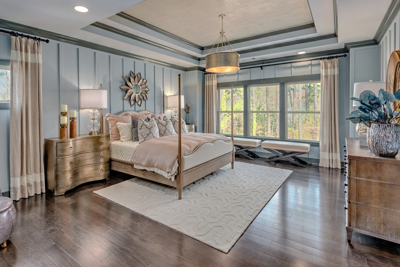 The owner's bedroom is something to behold with high tray ceilings, a walk-in closet, easy access to the master bathroom, and a laundry room within steps of the door.