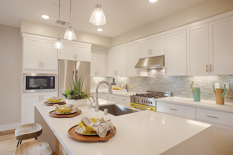Symmetry at Alameda Landing offers three-story, attached townhome-style condominiums with well-equipped eat-in kitchens and floorplans with two to four bedrooms.