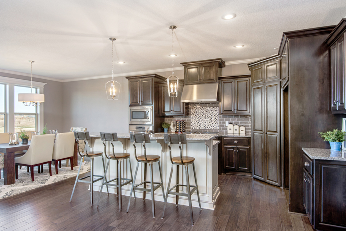 As part of Summit's Signature Collection, each home at Mill Creek comes with an Energy Star rated appliance package and built-in recycling space in the kitchen cabinetry.