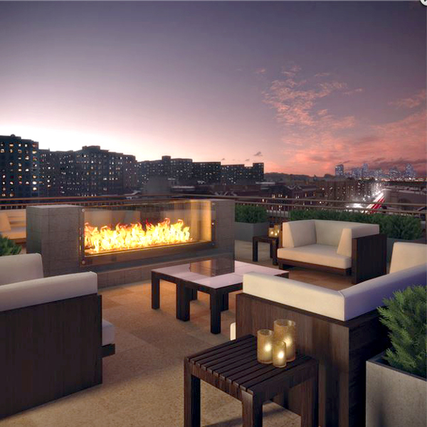 Scenic views of city skylines and a fireplace give this rooftop patio an edge.